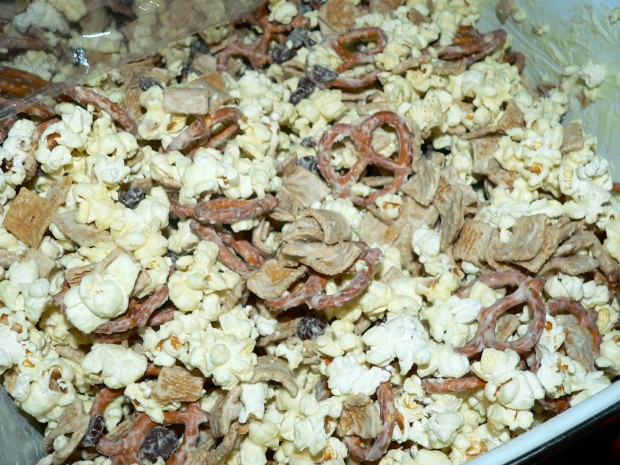 popcorn, pretzels, white chocolate, candy, cereal all mixed together for a gift.